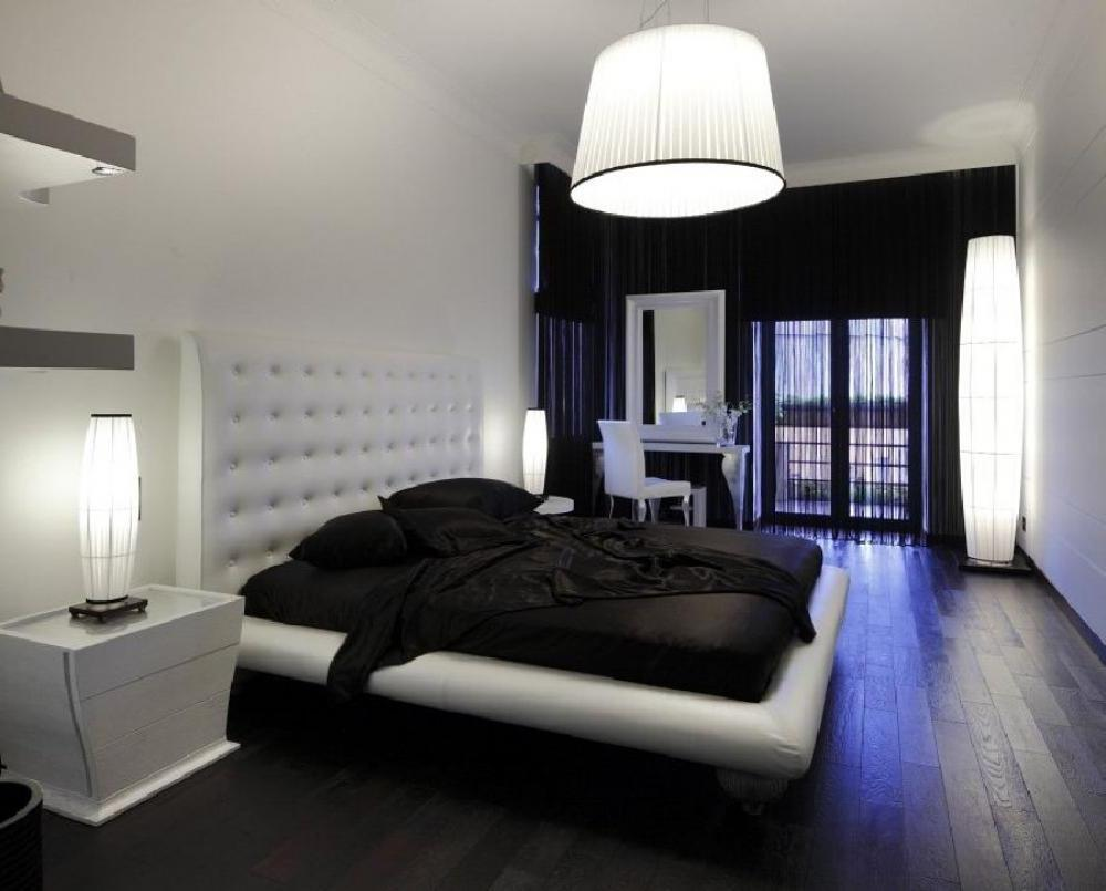 Moderne slaapkamer met donkere vloer.