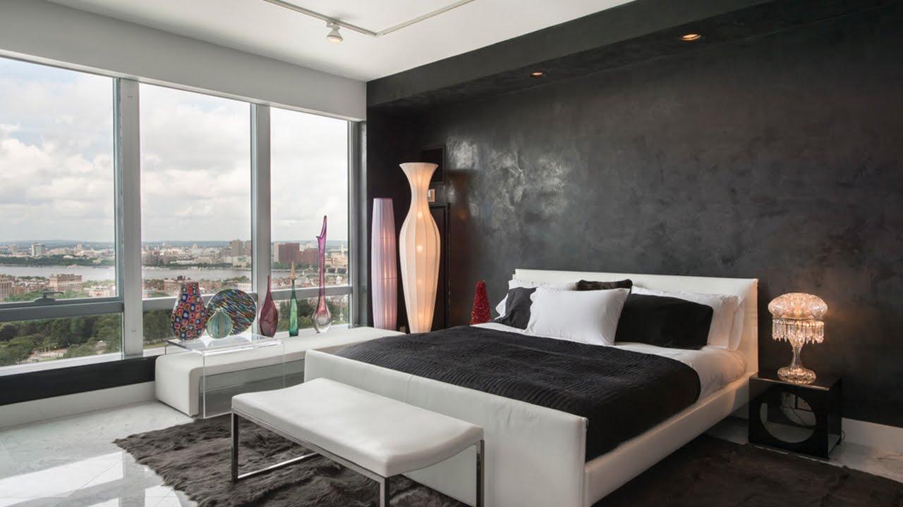 Slaapkamer met zwarte wand.